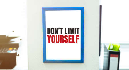 text DONT LIMIT YOURSELF , isolated white background with printer and folders Stok Fotoğraf