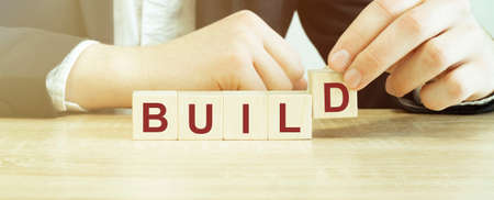 Man made word build with wood blocks Stok Fotoğraf