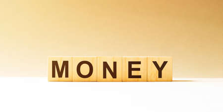 Word money made with wood building blocks