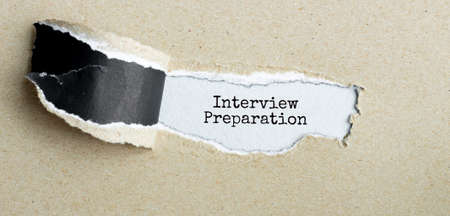 The text Interview Preparation appearing behind torn brown paper