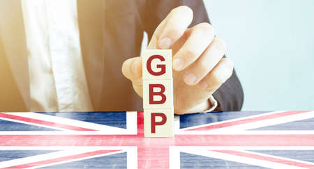 Man made word gbp with wood blocks with uk flag Archivio Fotografico