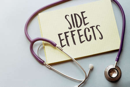 SIDE EFFECTS written on a clipboard, Medical concept