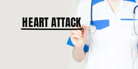 Doctor writing word Heart Attack with marker, Medical concept