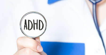 ADHD sign and hand with stethoscope of Medical Doctor