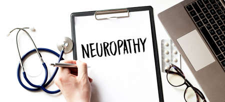 Man doctor writing word Neuropathy with pen, Medical concept
