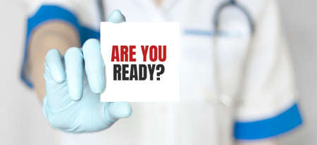 Doctor holding a card with text Are you ready, medical concept