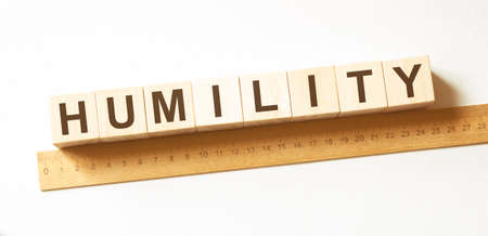Word HUMILITY made with wood building blocks 스톡 콘텐츠