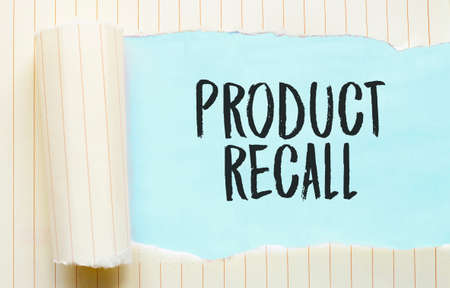 The text PRODUCT RECALL appearing behind torn white paper