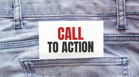 CALL TO ACTION words on a white paper stuck out from jeans pocket. Business concept
