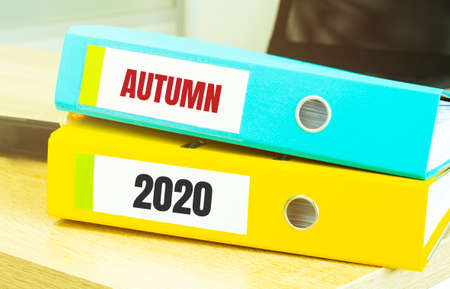 Two office folders with text AUTUMN 2020, business concept