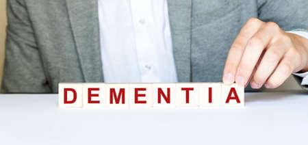 Word DEMENTIA made with wood building blocks Stock fotó