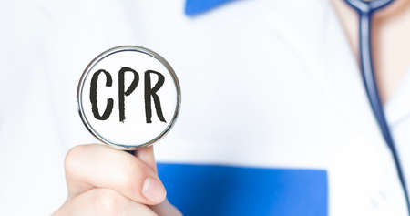 CPR sign and hand with stethoscope of Medical Doctor Фото со стока