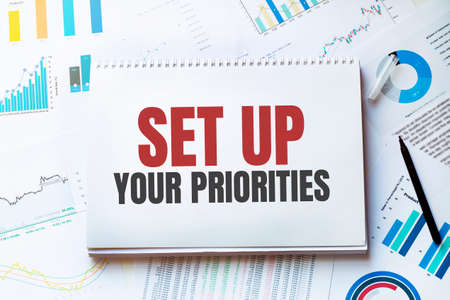 Notebook with Tools and Notes about SET UP YOUR PRIORITIES, concept Banque d'images