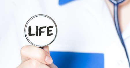 LIFE sign and hand with stethoscope of Medical Doctor