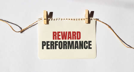 Card with text REWARD PERFORMANCE. Diagram and white background Banque d'images