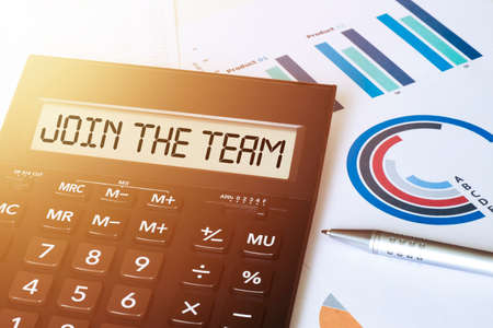 Word JOIN THE TEAM on calculator. Business and finance concept.