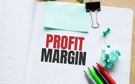 Notebook with Toolls and Notes about PROFIT MARGIN Imagens