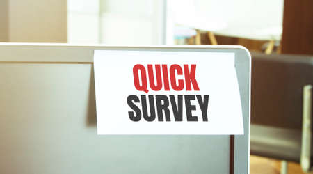Sticky note on the computer. Text QUICK SURVEY