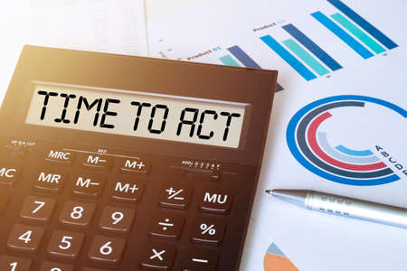 Word TIME TO ACT on calculator. Business and finance concept.