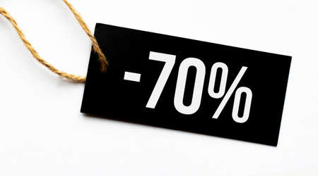 SALE 70 percents text on a black tag on a white paper background