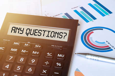 Word ANY QUESTIONS on calculator. Business and finance concept. Reklamní fotografie
