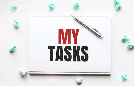 Blank sheet, pen and crumpled paper balls on gray table, flat lay. Text MY TASKS