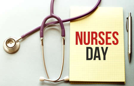 On a purple background a stethoscope with yellow list with text NURSES DAY