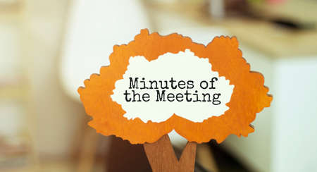 figure of a tree with text MINUTES OF THE MEETING inside the foliage. Business concept