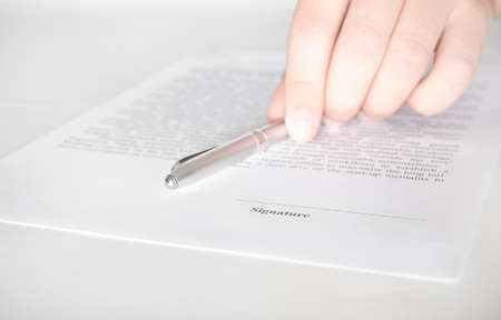 Businessman hold a pen on the contract. Contract signing, Business concept