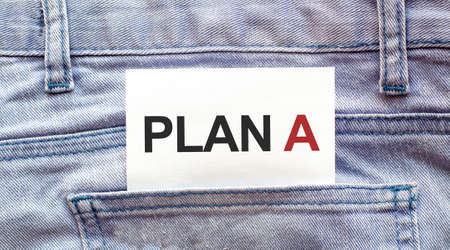 PLAN A words on a white paper stuck out from jeans pocket. Business concept