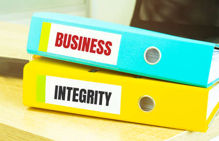 Two office folders with text BUSINESS INTEGRITY