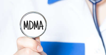 Doctor holding a stethoscope with text MDMA, medical concept Reklamní fotografie