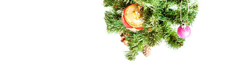 Decorated Christmas tree on white background. Golden toy ball and brown cone. Happy New Year 2021.Christmas mood. Atmosphere