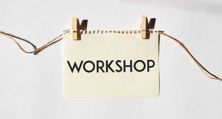 Card with text WORKSHOP. Diagram and white background
