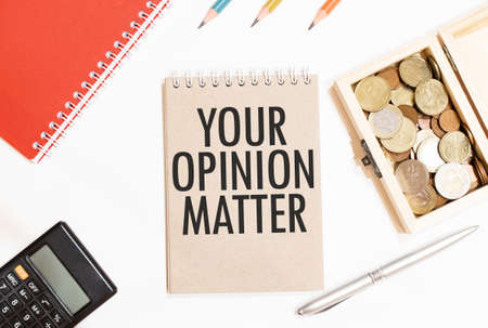 Calculator, red notepad, three color pencils, silver pen and brown notebook with text Your Opinion Matter