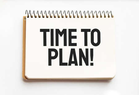 Notepad with text TIME TO PLAN. White background. Business