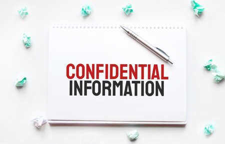 Blank sheet, pen and crumpled paper balls on gray table, flat lay. Text confidential information,
