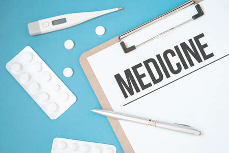 Notebook page with text MEDICINE on a table with a pills and pencil, medical concept, top view Stock fotó