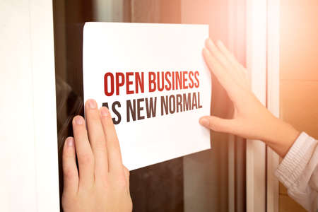 Reopening for business adapt to new normal in the novel Coronavirus COVID 19 pandemic. OPEN BUSINESS AS NEW NORMAL Stock fotó