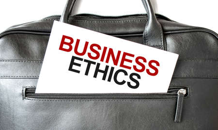 Text BUSINESS ETHICS writing on white paper shit in the black business bag. Business concept Stock fotó
