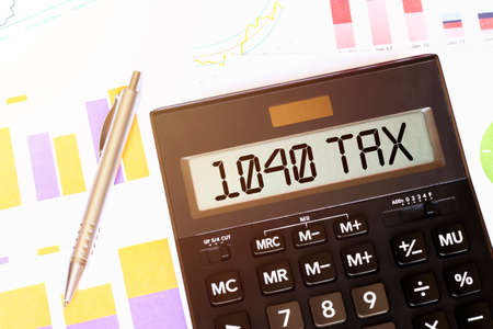 Word 1040 tax on calculator. Business and tax concept Stock fotó