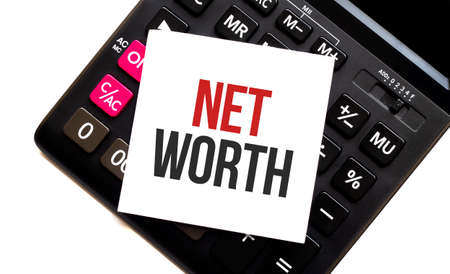 calculator with text net worth with white paper