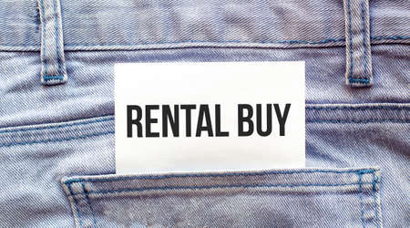 rental buy words on a white paper stuck out from jeans pocket. Business concept