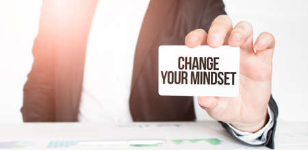 businessman holding a card with text Change Your Mindset Stock fotó