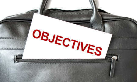 Text OBJECTIVES writing on white paper shit in the black business bag. Business concept Stock fotó