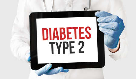 Doctor in holds a tablet with text DIABETEs