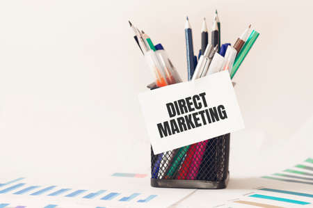 Card with text direct marketing on the pen box in the office. Diagram and white background Stock fotó