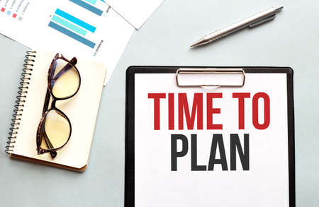 Business concept. Notebook with text TIME TO PLAN sheet of white paper for notes, glasses in the white background