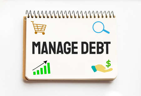 Notepad with text Manage Debt White background. Business
