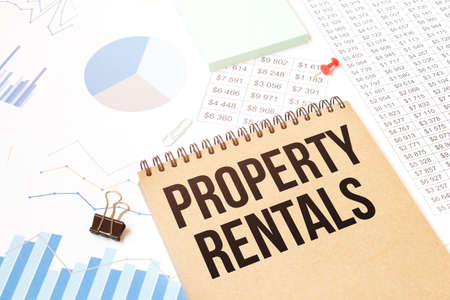 Notepad with text PROPERTY RENTALS. Diagram and white background